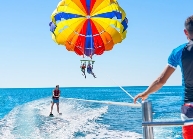 Parasailing Over The Pacific Ocean